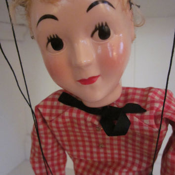 Vintage 1950's Marionette Hazelle Wooden Airplane Control Blonde Hair, Black Bow, Red Checkered Shirt with Gold Stars, and Blue Denim Pants