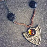 ostara a copper and amber tribal shield by RootsandFeathers