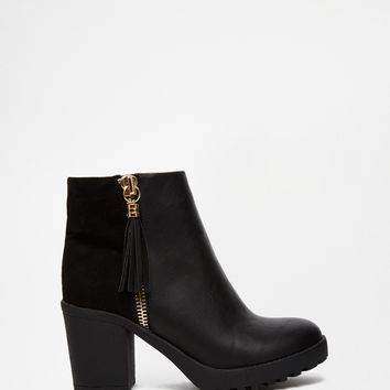 River Island Black Mid Heel Boot With Gold Zip Tassel at asos.com