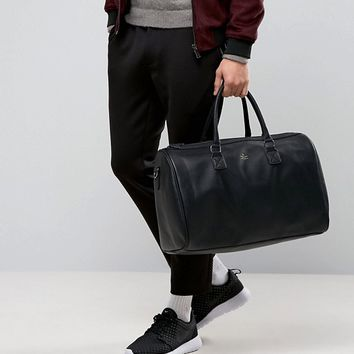 ASOS Holdall In Black With Gold Emboss at asos.com