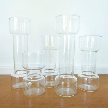 Five Pyrex Un Candle glass vessels, vases