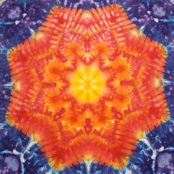 trippy tie dye star pattern tapestry or wall hanging in yellow orange red blue purple