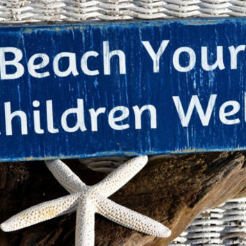 "Cute Beach Decor Distressed Wood Sign reads ""Beach Your Children Well"" in Hand Painted Lettering"