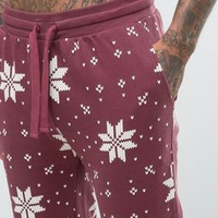 ASOS Loungewear Holidays Skinny Jogger With Snowflake Print at asos.com