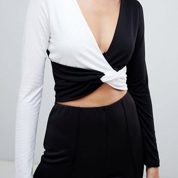 ASOS DESIGN long sleeve twist front colourblock top at asos.com