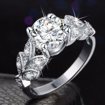 Women's Unique Leaf Design Crystal Diamond Wedding Engagement Ring Fashion JewelryMetal: Alloy+Crystal Ring Size(US): 6, 7, 8, 9, 9 Color: Silver, Gold  Package included:  1X Ring