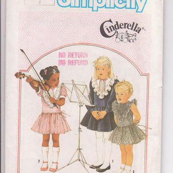 Vintage 1980s CInderella pattern for drop waist short dress with ruffled front yoke long or short sleeves girls size 4 Simplicity 6660 UNCUT