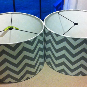 "Pair of  Drum Lamp Shades  in  a great grey / silver chevron print , lampshades are both 14""X 10"""
