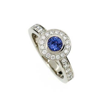 Blue sapphire halo engagement ring made from white gold, diamond, bezel, solitaire, unique, blue engagement, sapphire solitaire, blue halo