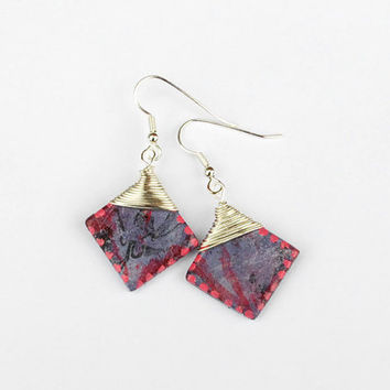 Wirewrapped purple earrings with a little pink.