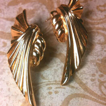 Givenchy Designer pierced earrings. Gold tone bow ribbondesign. Huge! Gold tone and very retro!