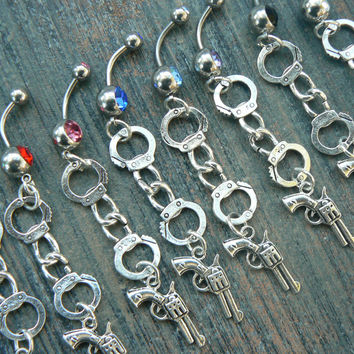 hand cuff and gun belly ring handcuff with revolver or pistol ONE