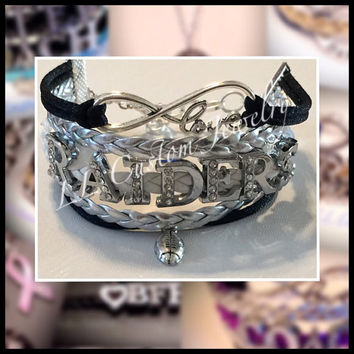 Multi-strand Love Raiders Football Rhinestone letters Bracelet with a Charm of your choice from the picture of charms.  You can Customize.