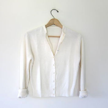vintage cashmere sweater. white cardigan from Dirty Birdies