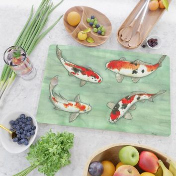 La ronde des carpes koi Cutting Board by savousepate