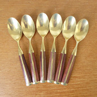 Six brass and wood dessert spoons, teaspoons