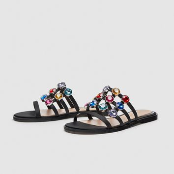 SLIDES WITH MULTICOLOURED BEJEWELLED DETAILING DETAILS