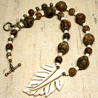 Carved Bone Leaf and Dzi Etched Brown Eye Agate Antique Brass Necklace