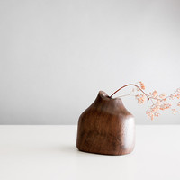Handcrafted vase made from walnut wood