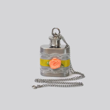 Flask Necklace 1oz flask with delicate white lace, yellow satin ribbon, and peach satin flower