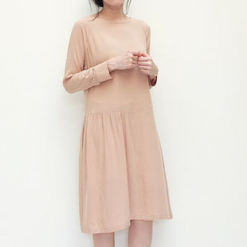 Neutral beige dress with basque waist design and ruching details