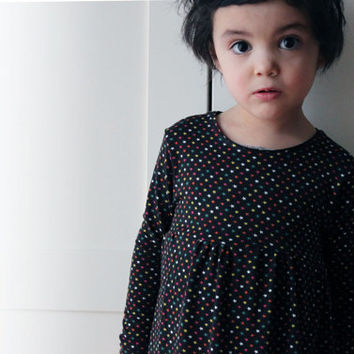 Girls' stretchy easy wear daytime dress. Black and multicolor tiny little stars. Long short sleeve your choice. Sizes 2T, 3T, 4y, 5y.