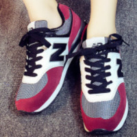 New Balance spring new sports and leisure wild student couple men and women shoes Red/black letter