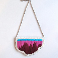 Embroidered abstract pendant necklace in ombre colors of light and dark violet and bright blue on a silver ball chain perfect for Spring