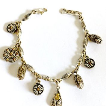 "Vintage Signed Napier Silver Toned Textured 7"" Charm Bracelet with tiny Gold Toned Accents for Sparkle"