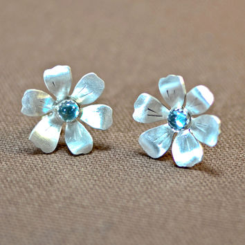 Sterling silver flower earrings with blue topaz