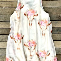 This print is a Summer time staple piece! Our Gimme Your Love Dress is a sleeveless sheer like dress with high neck that ties at the back. Bull head and floral print throughout and cut out back. Made to be flowy and lined for coverage.