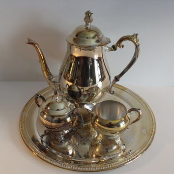 Silver plated tea or coffee set with platter by F B Rogers,signed on the bottom, great for any holiday and occasion.