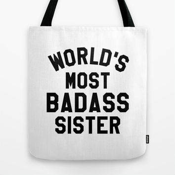 WORLD'S MOST BADASS SISTER Tote Bag by CreativeAngel | Society6