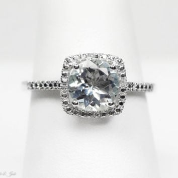 Sterling Silver Genuine 7mm Aquamarine & .01 CTW Diamond Halo Ring
