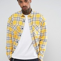 ASOS Oversized Longline Shirt In Yellow at asos.com
