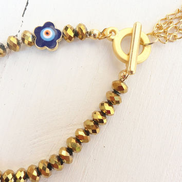 Shiny gold tone swarovski women bracelet with an evil eye - gold, girl, crystal, jewelry, birthday, christmas, gemstone, girl