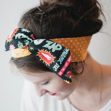 Large Dolly Bow, Comic Words with Orange Polka Dots, Pin Up Wire Headband Rockabilly Teen Woman
