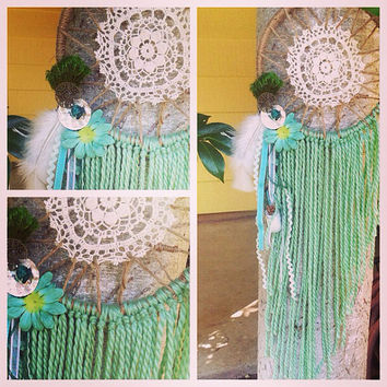 Dreamcatcher in greens and white feathers