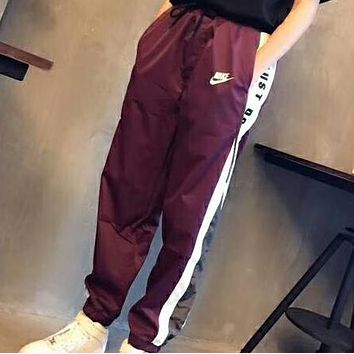 NIKE Fashion new print leisure sports loose women and men trousers pants Purple
