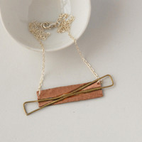 Copper, brass and silver abstract bow necklace