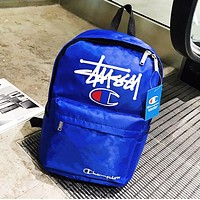 Champion & Stussy Fashion New Letter Print Leisure Backpack Bag School Bag Blue