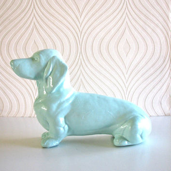 Dachshund Statue in light swimming pool blue