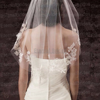 Single-Tier Lace Embellished Cage Veil Style VW370145 Single-tier cage veil with appliqued lace and three-dimensional floral detailing.
