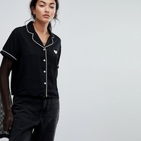 Lazy Oaf Beyond Repair Shirt With Heart Back at asos.com