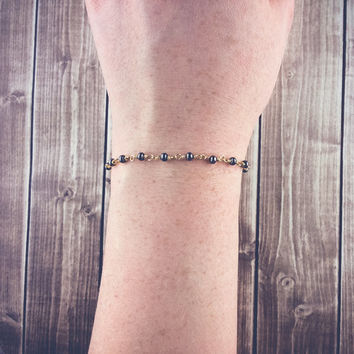 Wire-wrapped gunmetal bracelet | Simple gold bracelet, Dark gray bracelet, Layering jewelry, Metal beaded bracelet