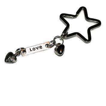 Love key chain with hearts and star