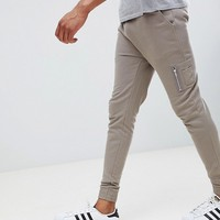 ASOS DESIGN tall skinny joggers with MA1 pocket in beige at asos.com