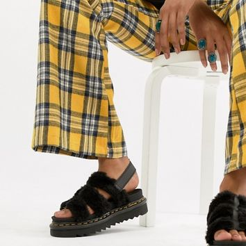 Dr Martens Yelena sandal in black teddy at asos.com