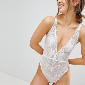 ASOS Blair High Leg Lace bodysuit With Lace Up Back at asos.com