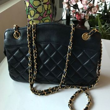 Authentic CHANEL Navy Quilted Lambskin Vintage Bag. Good used condition.